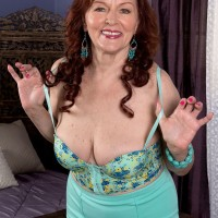 Redheaded 60plusmilfs.com model Katherine Merlot having legs and feet worshiped