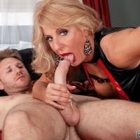 Busty blonde MILF over 60 Julia Butt facesitting man in stockings and garters