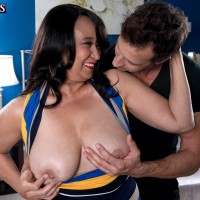Dark haired mature MILF over 60 Rochelle Sweet baring huge boobs for nipple play