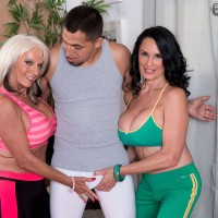 Golden-haired grandma Leah L'Amour gives her boy toy a hand-job in lingerie and hosiery