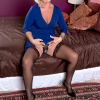 Clothed granny Jeannie Lou exposing large tits and crotchless pantyhose