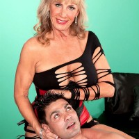 Blonde MILF over 60 Scarlet Andrews pinching nipples and taking doggystyle fuck