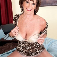 60 plus MILF Syndi Lane stripping down to brassiere and pantyhose for 60plusmilfs.com