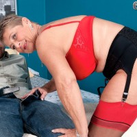 Stocking and garter adorned 60 MILF model fucking younger man in porn debut