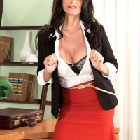 Leggy brunette granny in skirt and glasses stripped down to nylons for MMF 3some