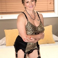 Cougar print lingerie attired granny giving BBC handjob in black stockings and heels