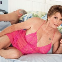 Over 60 granny Mona flashing pussy by way of crotchless pantyhose upskirt