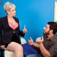 Short haired granny seducing younger man with a BJ before having sex in office