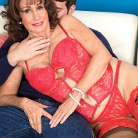 60 plus MILF Jacqueline Jolie freeing large mature tits from lingerie in stockings