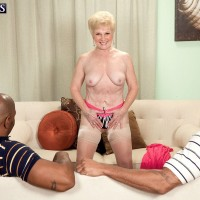 Horny granny in stockings undressing to jerk big black cocks before MMF sex