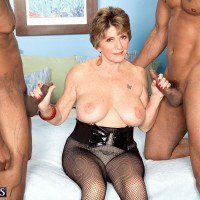 Busty 60 plus MILF Bea Cummins giving BBC handjob and BJ in MMF threesome