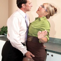 Skirt and pantyhose attired 60 plus MILF Luna Azul giving bj at work in high heels