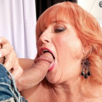 Yellow-haired grandma Marina Johnson has her first multiracial sex experience in a red dress