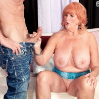 Chubby redheaded 60 plus MILF Jackie baring huge boobs and giving blowjob