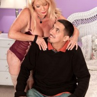 Stocking and garter attired 60 plus MILF Lexi McCain seduces younger man
