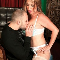 Stocking and garter clad MILF over 60 Lexi McCain baring big boobs for tit sucking