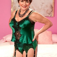 Hose and garter adorned 60 plus MILF Bea Cummins baring large granny tits