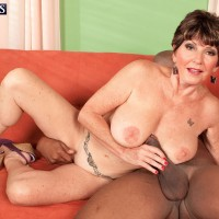 60 plus MILF with large tits fucking big black cock while cuckold husband watches