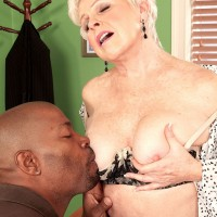 Hot blonde granny Lexi McCain letting big knockers loose in sexy lingerie