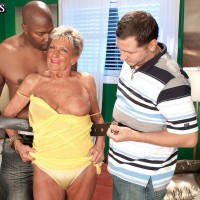 Tattooed GILF Sandra Ann engaging in hardcore interracial MMF threesome