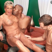 Over 60 brown-haired MILF Rita Daniels showing off fine legs and immense fun bags