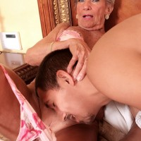 Sexy grandma Mimi Moore gives a humungous ebony prick fellatio in seductive lingerie and tights