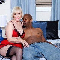 Lingerie attired mature pornstar Lola Lee taking hardcore interracial fucking