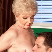 Older cougar Jewel flashing upskirt panties to seduce younger man for sex in office