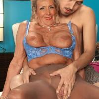 Stocking and lingerie attired 70 plus MILF pornstar Sandra Ann baring big tits