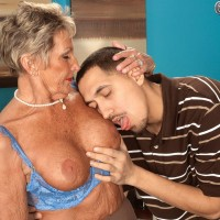 Over 60 granny Charlie jerking and sucking a younger man's cock