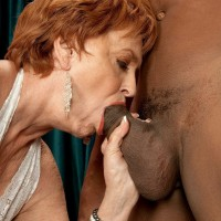Redhead mature babe with big tits having hardcore interracial sex with BBC