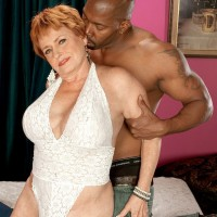Tan stocking attired granny flashing big tits before giving younger man oral sex
