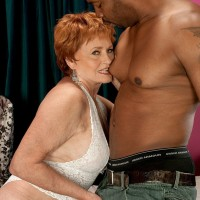 Redheaded milf having an interracial hardcore sex