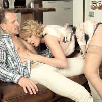 Mature blonde woman Amy gives her date a blowjob after teasing him on the sofa