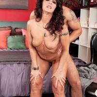 Brunette 50 plus MILF Azure Dee seduces a younger Latino boy