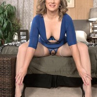 50 plus cougar Catrina Costa teases her younger lover while she has him tied up