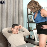 Over 50 MILF Catrina Costa seduces a younger man wearing a black miniskirt