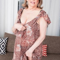 Thick MILF over 60 Crystal King has her big boobs played with by her toy boy