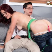 Sexy 50 plus MILF Dana Devereaux seduces a younger man with her glasses on