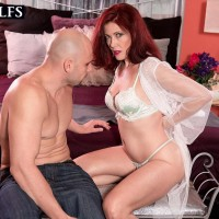 Over 50 redhead Dana Devereaux gets on top her toy boy's cock during sex