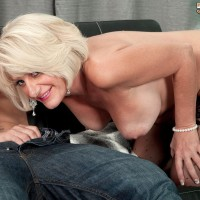 Sexy 50 plus MILF Desire Collins blows her toy boy's hard cock in sensual lingerie