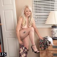 Sexy 50 plus blonde Heidi seduces her daughter's boyfriend with a panty flash