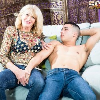 Sexy over 50 MILF Kendall Rex is stripped down to her bra and a thong by a younger Latino boy