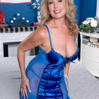 Over 50 MILF Laura Layne shows her thong clad ass to a younger boy in lingerie