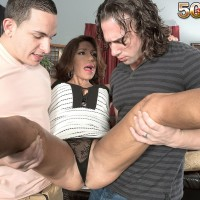 Over 50 MILF Layla LaMora takes a couple of big dicks from younger boys in hand