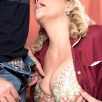 Busty 50 plus MILF Lena Lewis seduces a younger boy after baking him a cake