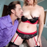 Mature MILF Rebecca Williams awaits her lover's arrival in sexy lingerie and nylons