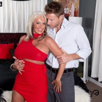 Big titted MILF over 50 Sally D'Angelo is freed from a red dress by her toy boy