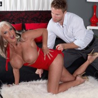 Hot 50 plus MILF Sally D'Angelo has her huge tits exposed by her younger lover