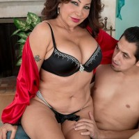 Thick 50 plus Latina MILF Sandra Martines is freed from lingerie by her toy boy